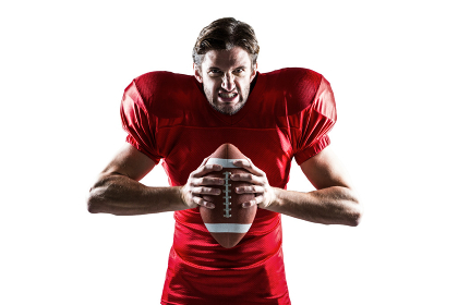 Angry American football player in red jersey holding ball