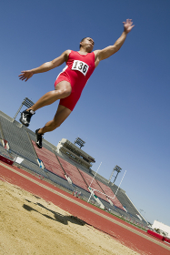 Male Athlete Doing A Long Jump
