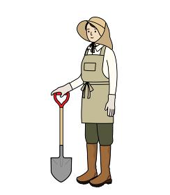 農作業の服装。農業、ガーデニング、家庭菜園。シャベルを持った女性。