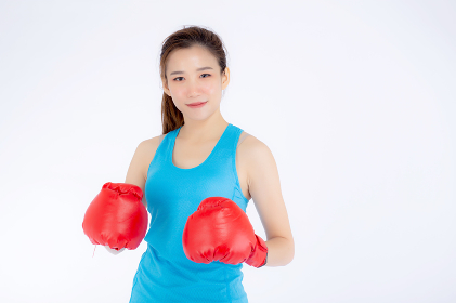 Beautiful portrait young asian woman wearing red boxing gloves w