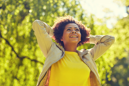 happy african american young woman in summer park