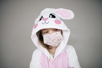 beautiful girl dressed as easter bunny rabbit with face protective mask during the corona  corvid 19 lockdown