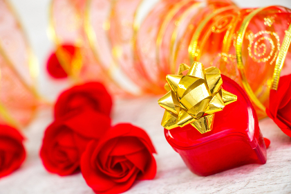Surprise ring box and red roses on Valentine's Day