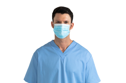 Portrait of Caucasian male doctor wearing face mask and scrubs looking at camera on white background. Medicine health coronavirus Covid 19 pandemic.