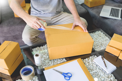 e-commerce shopping company concept, business entrepreneur seller prepares the delivery box for the customer.