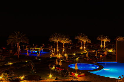 Sharm El Sheikh, Egypt - April 7, 2017: Evening view of swimming pool at luxury hotel Barcelo Tiran Sharm 5 stars at night
