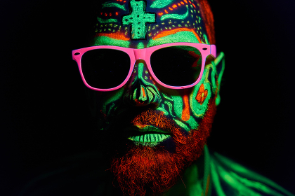 middle-aged man with neon makeup