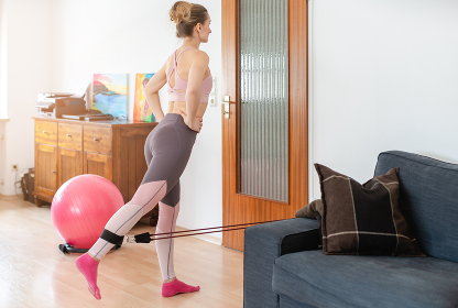 Beautiful woman staying fit during quarantine doing fitness exercise at home