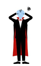 ハロウィンの仮装、バンパイア姿の男性が頭を抱えて困っているポーズ