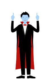 ハロウィンの仮装、バンパイア姿の男性が両手で指さしをするポーズ