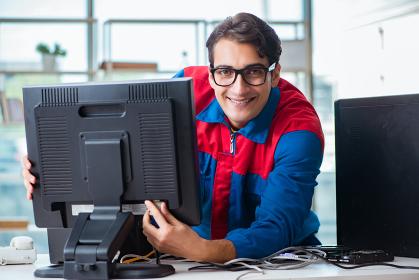 Computer repairman working on repairing computer in IT workshop. The computer repairman working on repairing computer in it workshop