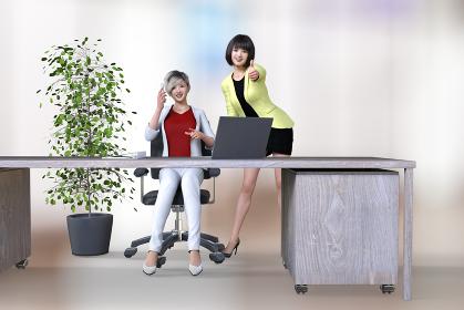 やる気と元気がいっぱいのショートヘアとボブヘアの女性社員が2人でパソコンの前でハンドサインをする