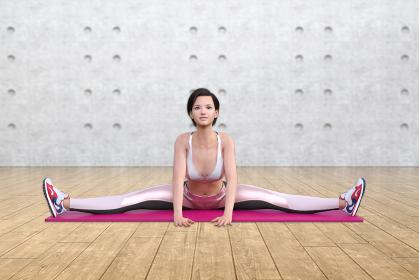 開脚をしてピンクのマットの上でストレッチをするスポーツジムに通う女性