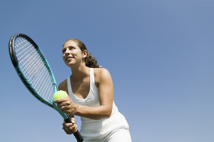 Female Tennis Player Preparing to Serve low angle view