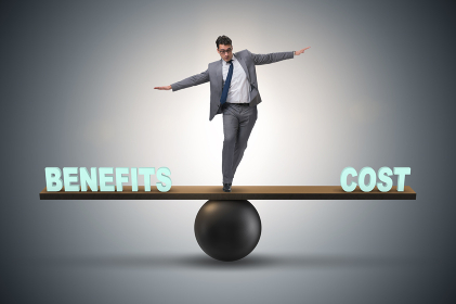 Businessman balancing between cost and benefit in business conce. Businessman balancing between cost and benefit in business concept