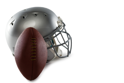 Close-up of helmet and American football