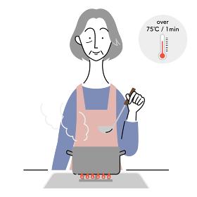食中毒予防のために加熱調理をするシニア女性