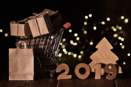 New Year background 2019.Gift boxes on shopping trolley.