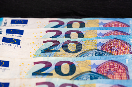 Selective focus on detail of euro banknotes. Close up macro detail of money banknotes, 20 euro isolated. World money concept, inflation and economy concept