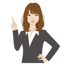 指差しポーズでスーツ姿の女性会社員