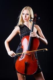 Woman playing cello on white