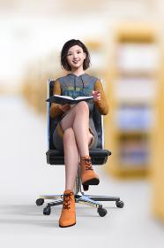 図書館で椅子に座り足を組んだパーカーワンピースを着た黒髪ボブヘアの笑顔の女子が本を膝の上で広げている
