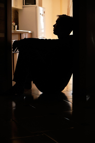 A man alone with himself in an empty apartment is experiencing lonelin, Lviv, Lviv Oblast, Ukraine