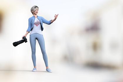 デニム生地が似合う爽やかなショートヘアの女性カメラマンが撮影で指示を出しつつシャッターを切る