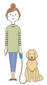 犬の散歩をする若い女性 ママ
