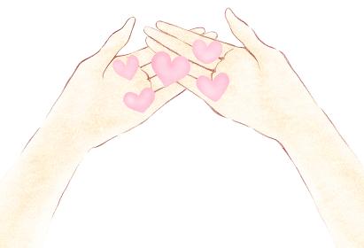 小さいピンクハート 優しい沢山の愛を手のひらに受け止める