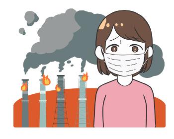 工場の火災 黒煙 マスクの女性