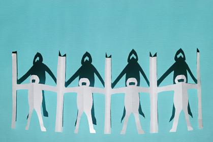 新型コロナ対策で衝立を挟んで繋がる人々の切り紙と影。青い背景とコピースペース。