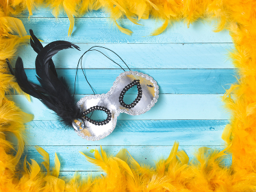 blue carnival background with yellow feathers