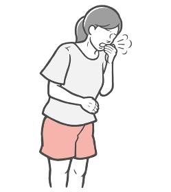 口を手で押さえて咳をする若い女性