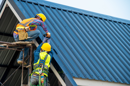 Professional and qualified roofer in protective uniform wear