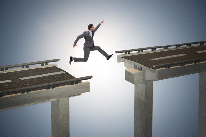 Young businessman jumping over the bridge
