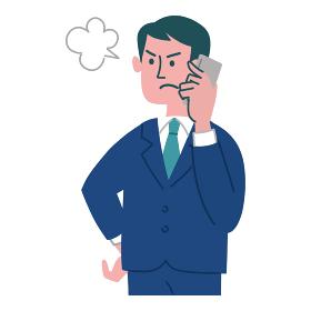 スーツ 男性 怒っている 携帯電話 立っている
