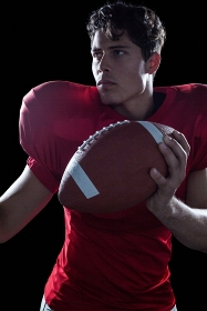 Confident American football player playing