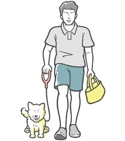 犬の散歩をする若い男性