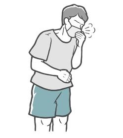 マスクをした状態で、口を手で押さえて咳をする若い男性