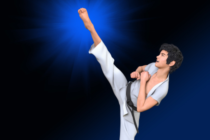 空手の技の練習をしている男の子が右足を天高く蹴り上げる