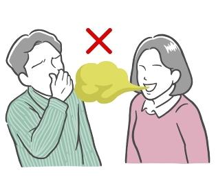 口臭がきつい若い女性と鼻をつまむ若い男性