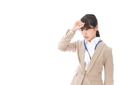 ビジネスウーマン・頭痛