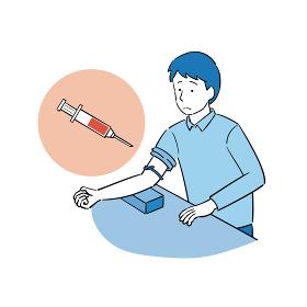 採血をする男性