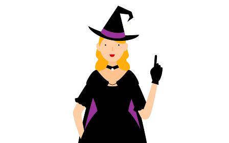 ハロウィンの仮装、魔女姿の女性が指さしをするポーズ