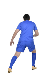 Rear view asian soccer player in action