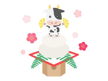 鏡餅にのった牛のキャラクターのイラスト