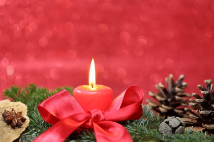 burning candle with bow