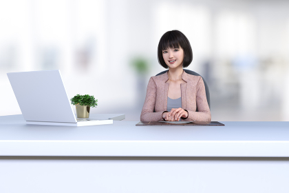 白いノートパソコンの前に座る可愛い笑顔のボブヘアの受付のオフィスレディ