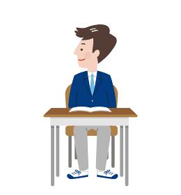 席に座って横を向く笑顔の男子学生